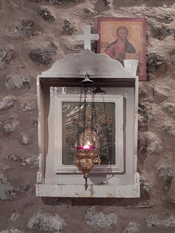 A lamp is kept lit in the Monastery bakery before an icon of the Virgin Mary of the Burning Bush.