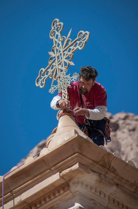 Michael attaching the cross on top of the bell tower