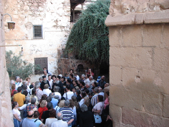Elder Pavlos with pilgrims at the Burning Bush.
