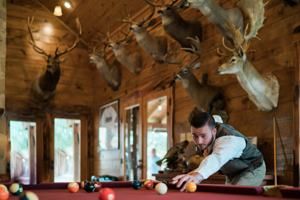 groomsmen playing pool