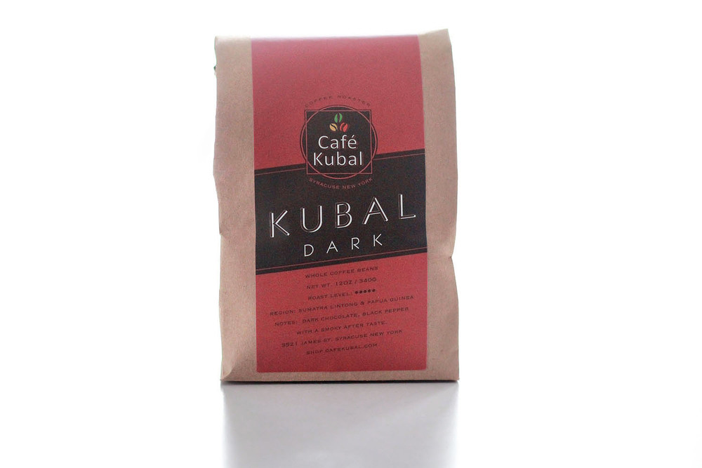 Kubal Dark is our signature dark roast Sumatra blends with Papua New Guinea. Often, Sumatra beans are harvested only once, yielding uneven batches of ripe and green cherries, but the farmers we purchase from handpick their beans at three different times to ensure that only properly ripened cherries are selected. Similar to a French roast and offering a pungent, spicy finish, our Kubal Dark has hints of black pepper and finishes with a smoky after taste. It is a medium body with low acidity. Hints of molasses can be detected as well, making it pair especially well with a sweet treat like our white chocolate cranberry oatmeal cookies or our famously addictive monkey bread. Roast : Dark Region : Lintong and New Guinea  Notes : Sharp, Earth, Smoke, Molasses and Spicy