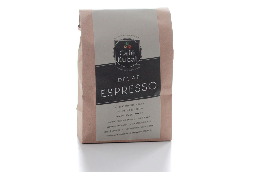 Cafe Kubal Decaf Espresso comes from Decaf Brazil beans. It is Swiss Water Processed and aged longer for a different brewing result. Swiss Water Process is chemical-free and produces beans that are 99.9% caffeine free. We let the freshly roasted Decaf Brazil de-gas for a few days before we use it at the espresso bar for a better extracting result. Our decaf coffee has a medium body and a chocolatey smooth taste. Roast : Medium Process : Swiss Water Processed/Aged Brazil Notes : Peanut, Milk Chocolate