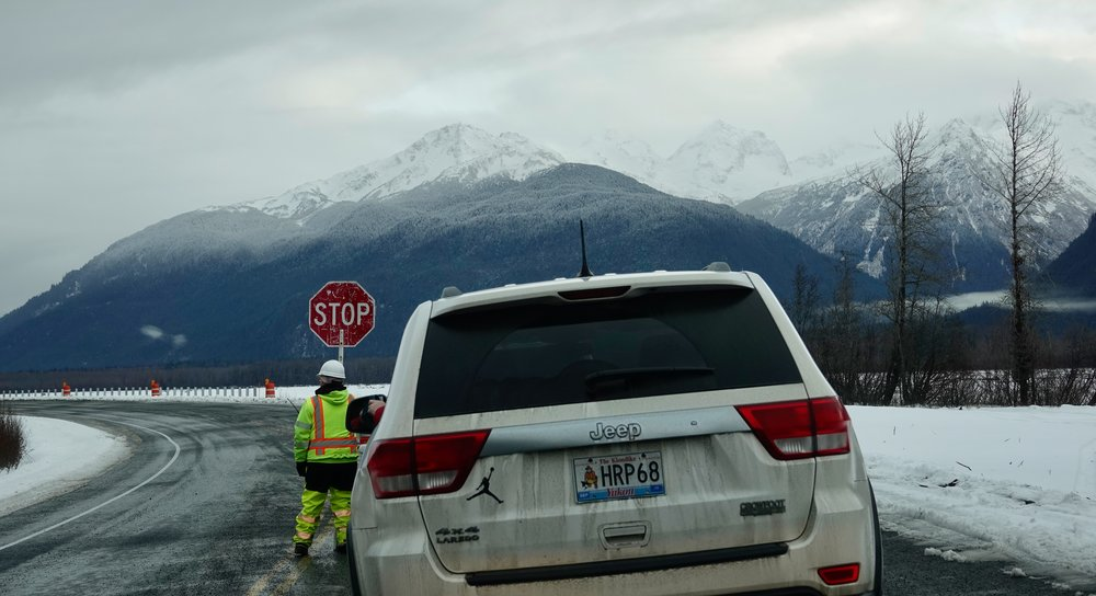The scenery made waiting for a pilot car on the Haines Highway in Alaska a most pleasant time. Road work is ubiquitous.