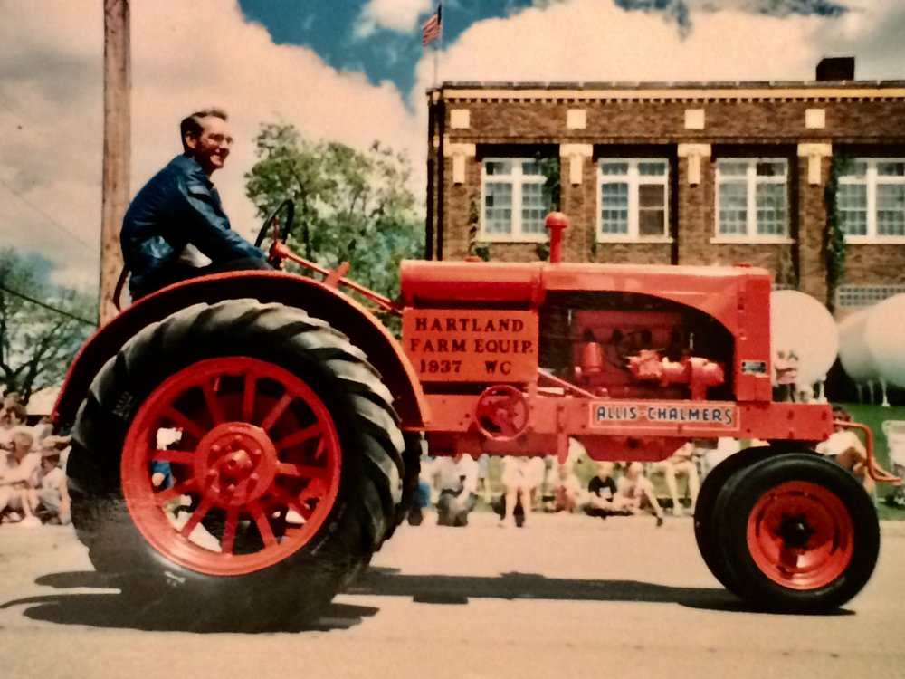 My brother loved a parade — as long as he was driving a tractor.