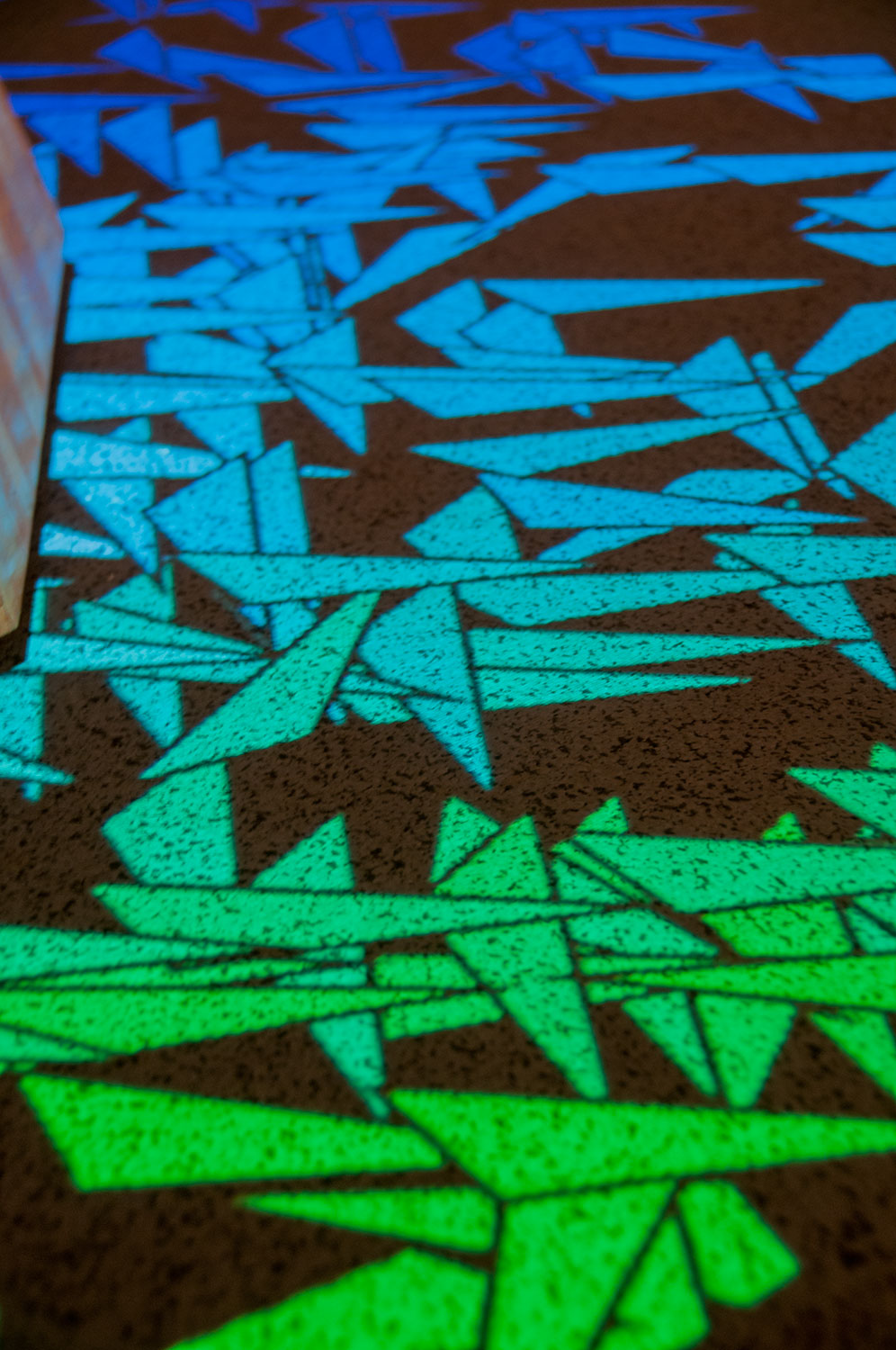 Mapping a projection to the floor was a means of presenting users with a map of colors which coincide with the this interactive sculpture.