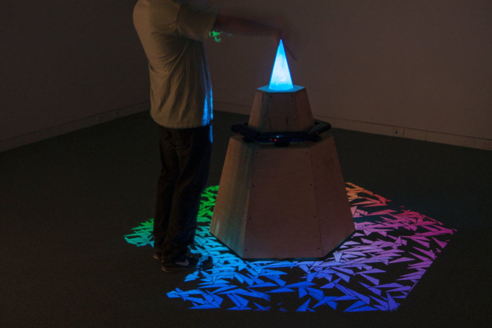Artist  Evan Coronis  interacting withthe Color Wheel.