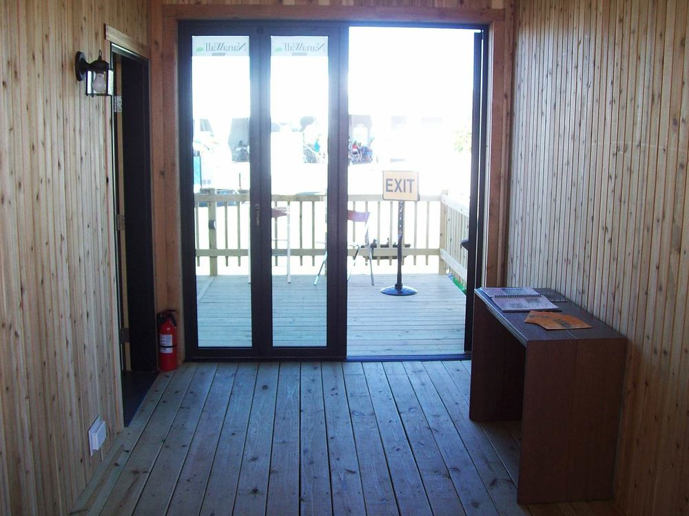 Outside the front door and NanaWall porch door.