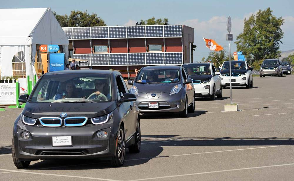 Solar Decathlon EV Parade! Our BMW i3 is the first white one with Avery Sandler and Taylor Kelley.