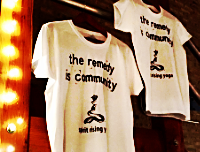 """the remedy is community"" 100% cotton tee shirt"