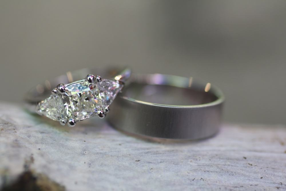 Wess & Laura Van Pelt - Custom Three White Diamond Ring with Trillions WG Satin Finish Platinum Band with Inscription_23.jpg