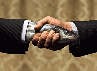Nick has never handed a client a fresh fish, nor does he wear a suit to work. Handshakes do happen frequently though.