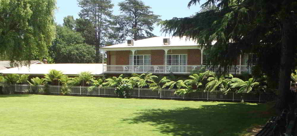 Rear of John Bright Motor Inn overlooking community croquet court.