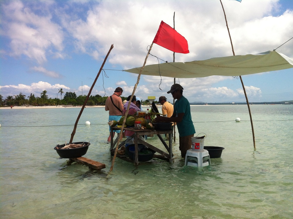 High tide or low tide... The locals still selling their fresh seafood including abalone.