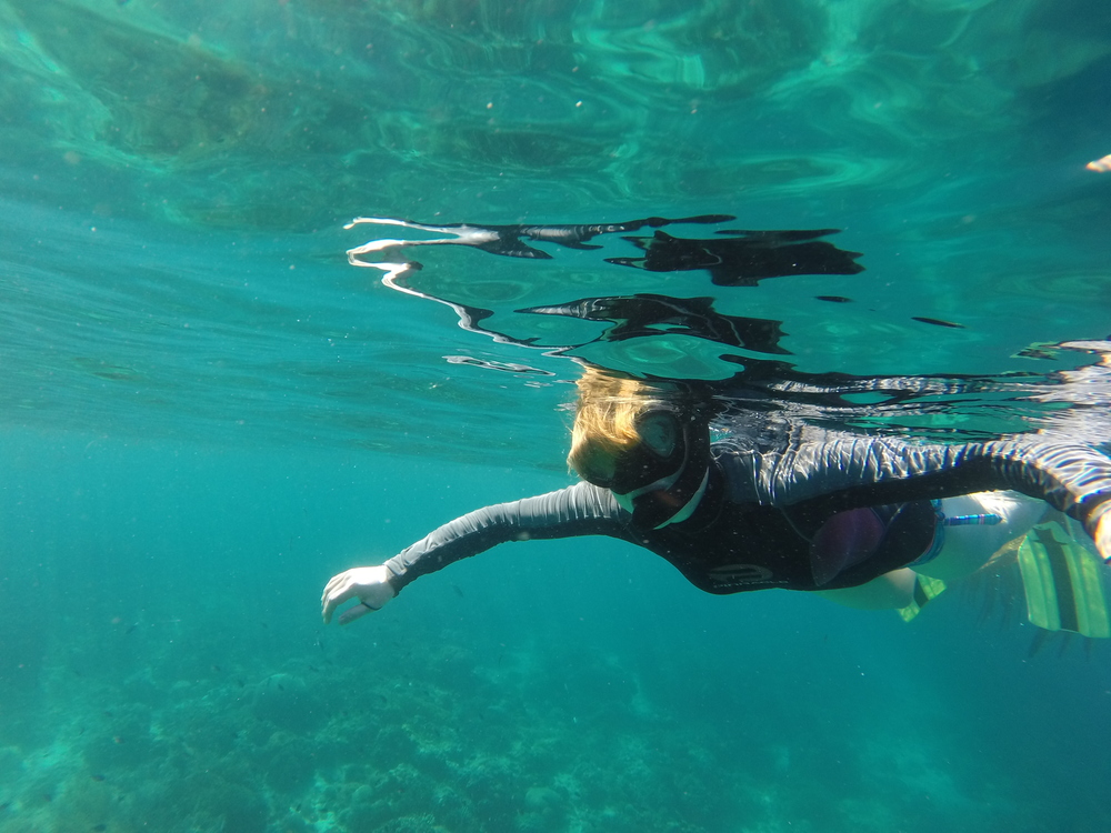 Kirsten Orschulok from Germany enjoying beach paradise, snorkeling in Balicasag Island.