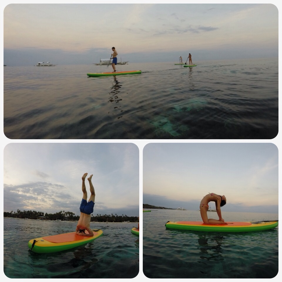 Charmaine from Hong Kong and Oriol from Spain on the SUP boards during sunset.