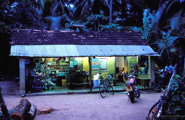 Village shop at dusk lit by solar panels © Dominic Sansoni / World Bank