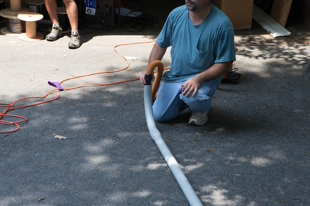 Using vacuum to get end through to 'other' end of conduit