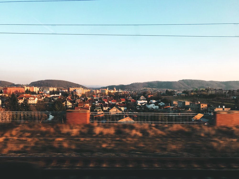 Our train races from Prague to Ostravicí as the sun begins to set