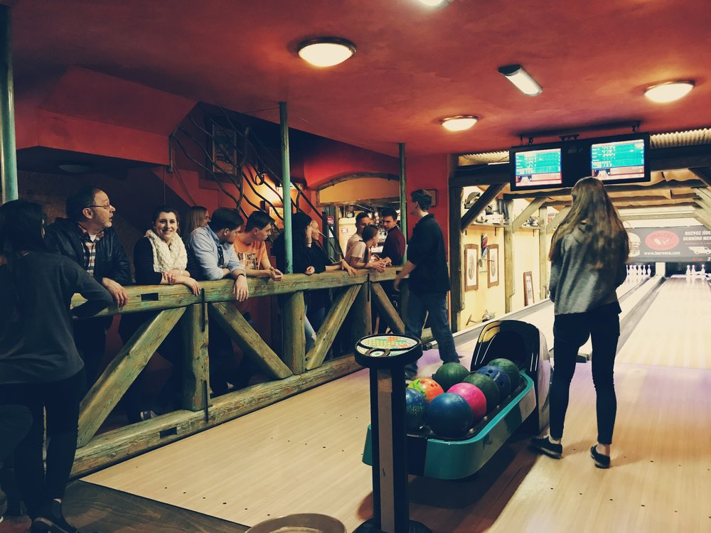 Our team bowls (poorly) at a local restaurant with our Czech friends
