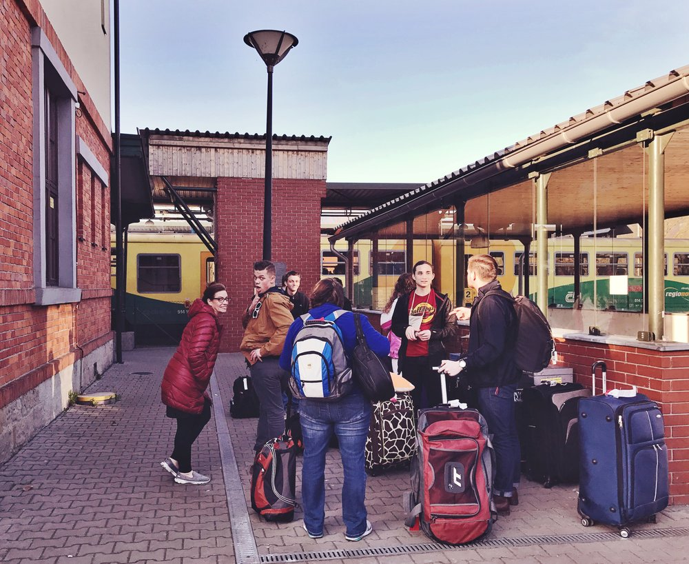 Part of our team waits for the train that will take us back to Prague
