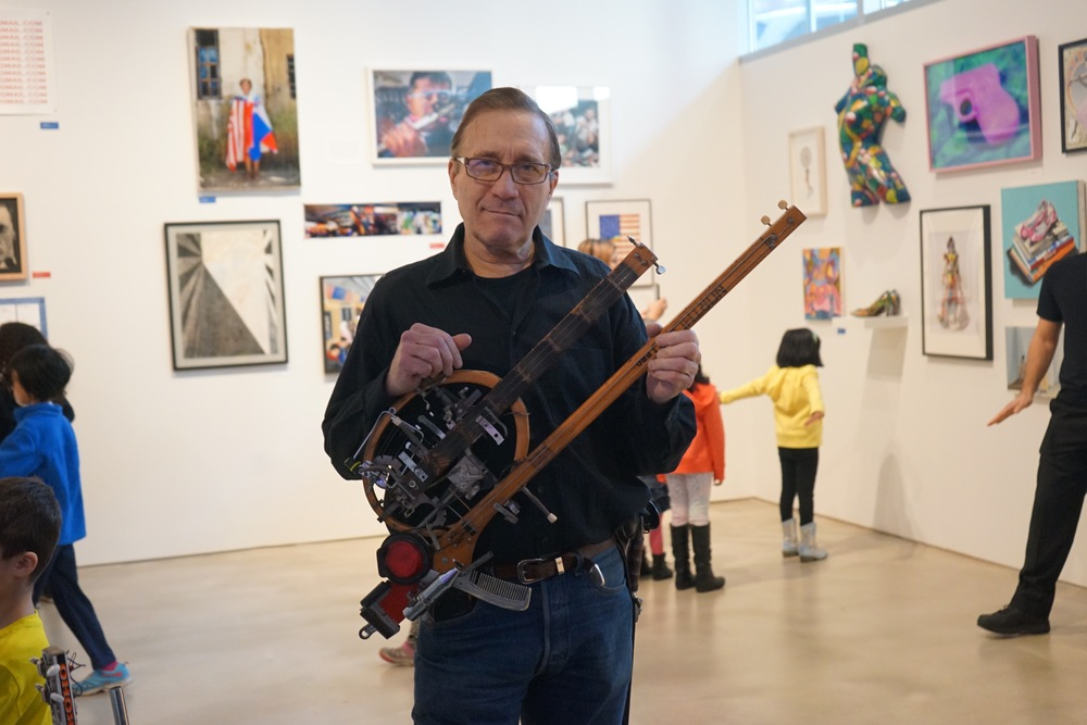 Ken Butler, with some sort of hockey stick violin-guitar-banjo hybrid thing that can only be described as next-level.