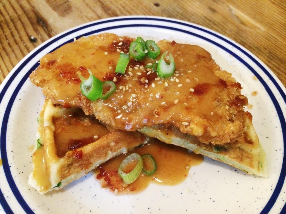 Pork Donkatsu + Kimchi Scallion Waffles smothered in donkatsu gravy & sambal maple syrup