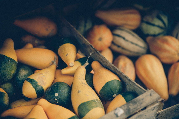 Image of a wooden box full of squash which are full of complex carbohydrates