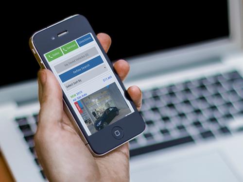 holding_iphone_custom_500x375_v2.jpg