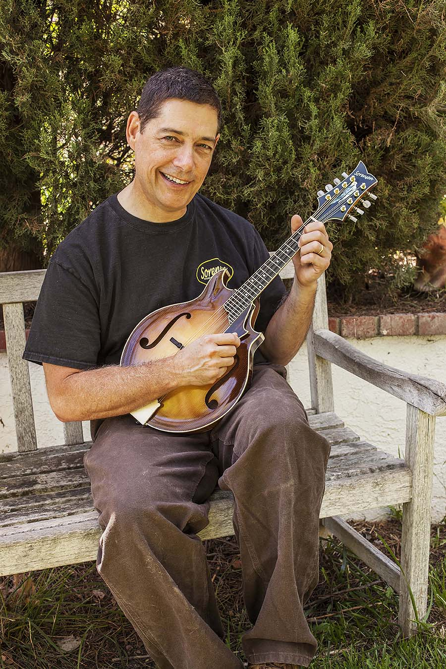 Steve sorensen with a sprite two-point mandolin, Photo by Hermon Joyner.