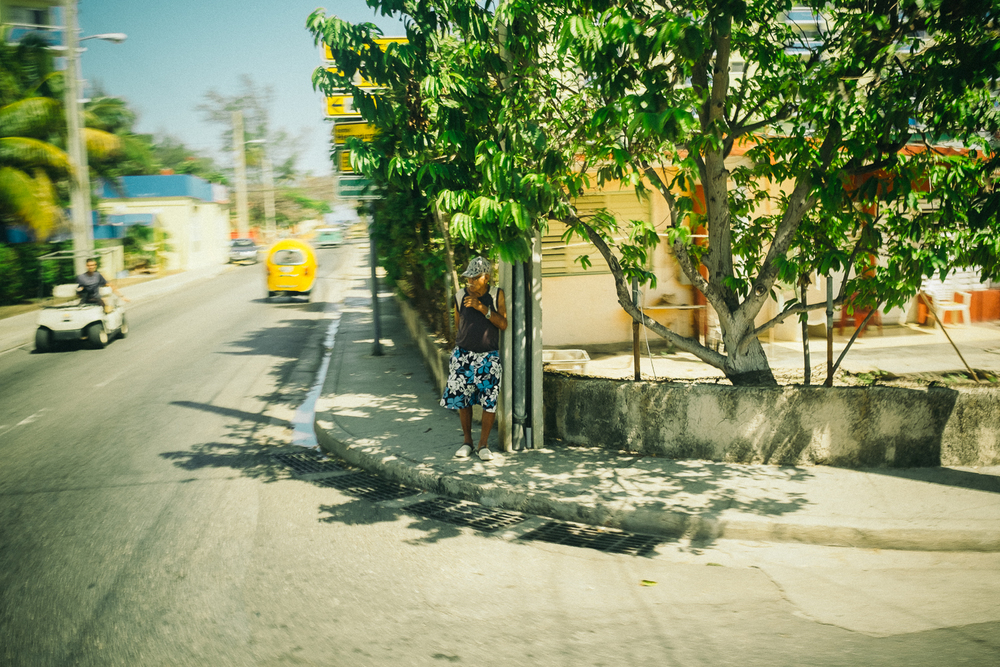 Man on a street corner in Varadero, Cuba 2015.