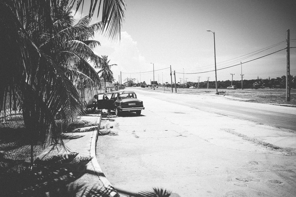 Old car parked on the side of the road in Varadero, Cuba 2015.