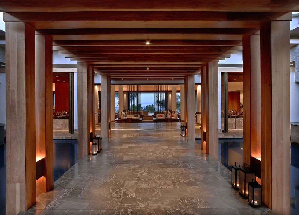 This entry makes such a statements with these gemoetric beams framing the lobby space.