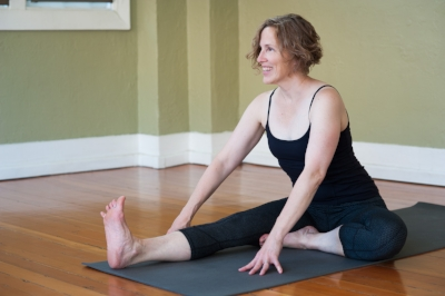 """Mary Beth has been exploring yoga as both a philosophy and physical practice since the early 1990s and has been teaching since 2009. While not a formal Sanskrit scholar in an academic sense, she has been a lifelong language """"nerd."""" She has a Bachelor's in Spanish with a concentration in Linguistics and she had intended to go on to a PhD in Linguistics but life took a different path. It's not a surprise that when yoga took a firm hold on her life she was drawn to the sounds and lore of Sanskrit. To share her love of the language and provide a peep-hole into the philosophy of yoga she developed this accessible and entertaining workshop, which she has taught to curious practitioners and teachers in training around the Bay Area."""