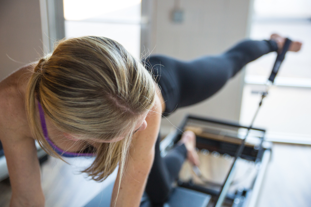 REFORMER PILATES    FLOW BETWEEN THE REFORMER AND WUNDA CHAIR IN THIS EQUIPMENT FOCUSED CLASS. YOUR INSTRUCTOR WILL WORK WITH YOU MORE INDIVIDUALLY TO ACHIEVE BALANCED MUSCLE DEVELOPMENT, ALIGNMENT, COORDINATION, BODY AWARENESS AND CORRECT FORM.
