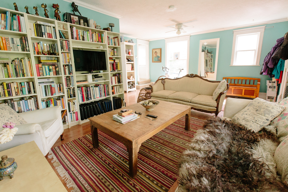 Hannah's living room is an eclectic, cozy mix of books, art, and souvenirs from her travels.