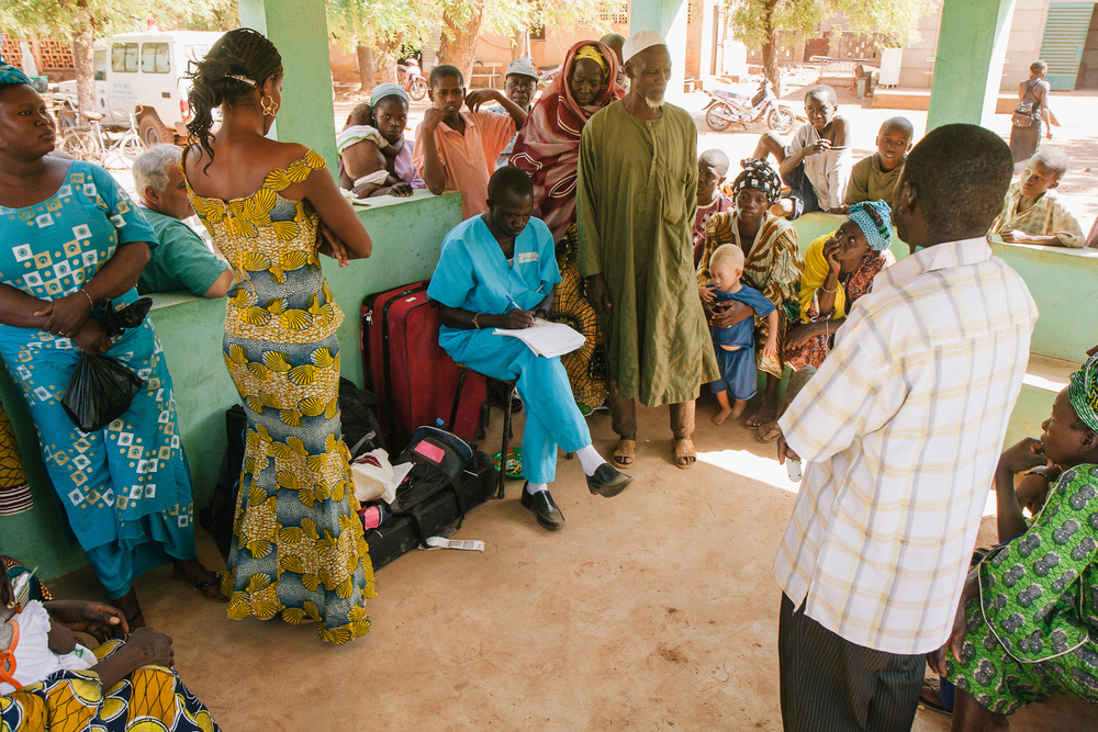 Malian and Utahn dentists, hygienists, and translators work in teams at emergency dental clinics held in the Ouelessebougou area. Each day, large numbers of patients line up to be assessed - in many cases, emergency extraction or surgery is required to halt serious infection.