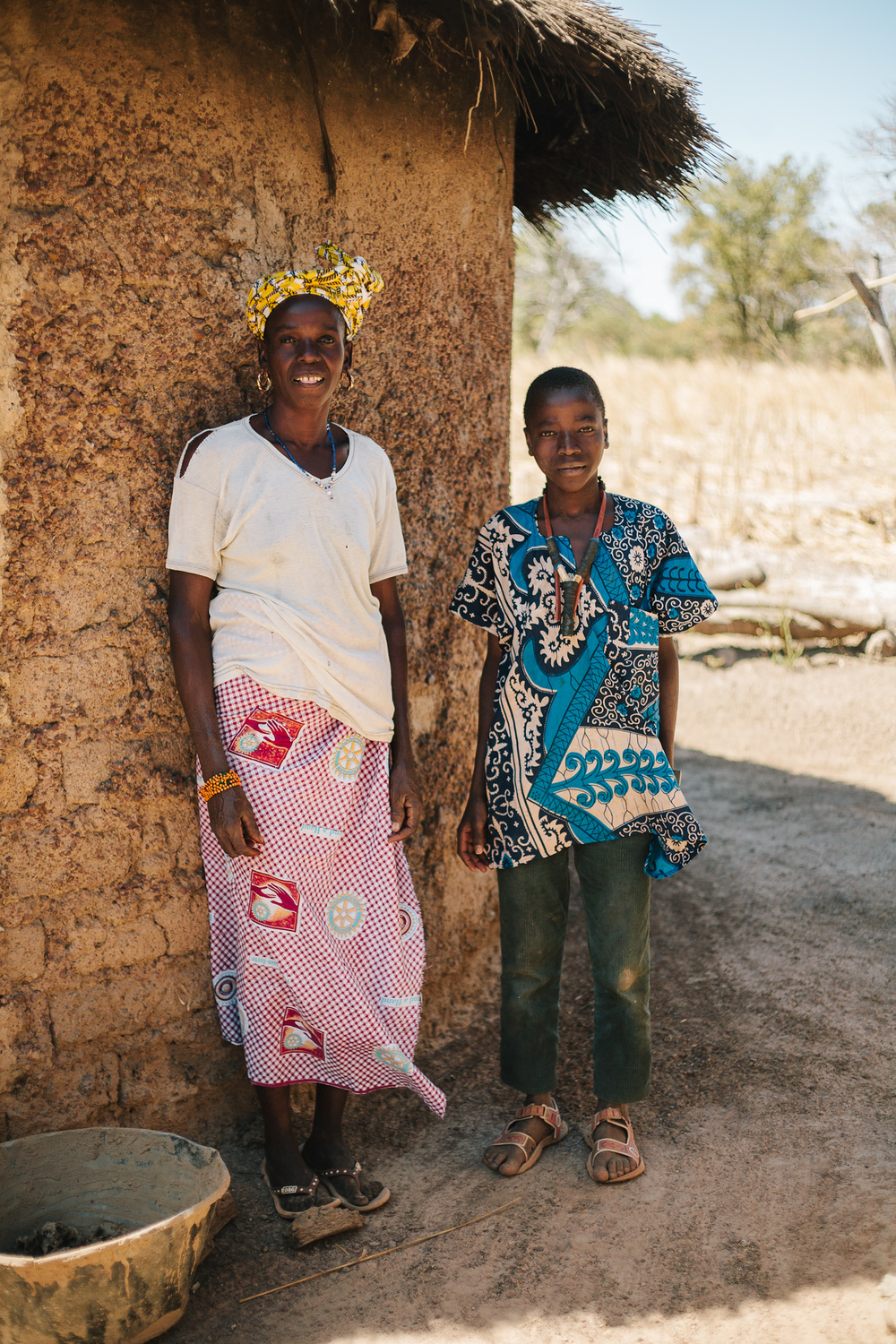 Moussa Samake and his mother, outside their home in Beneko.