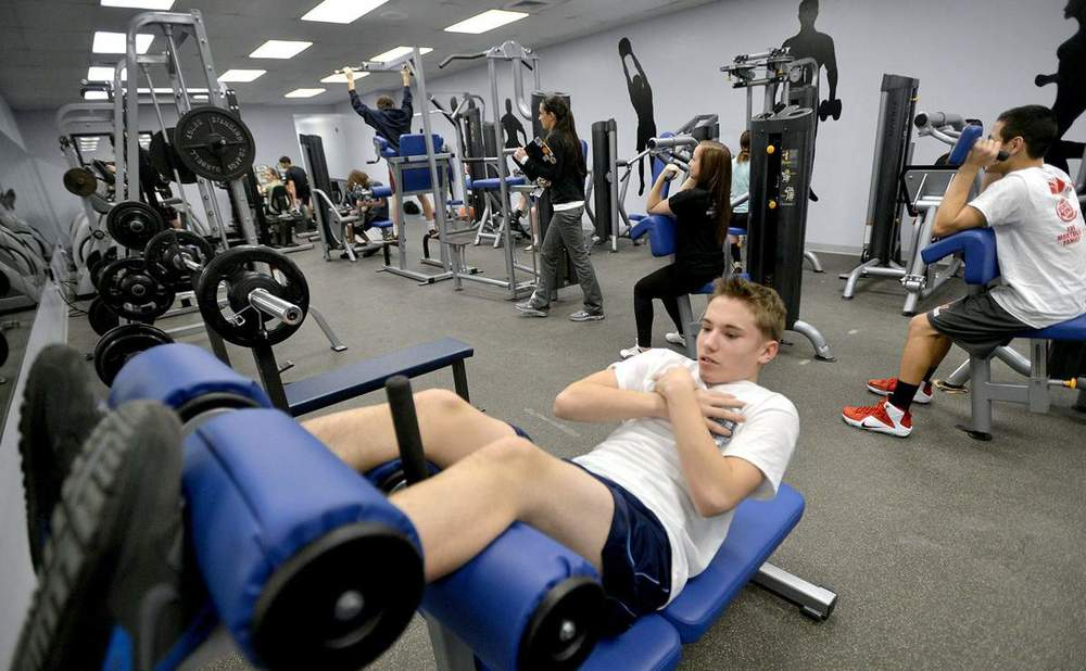 Freshman Michael Allen, 15, of Erie, performs sit-ups on the incline ab machine Jan. 7 in Northwest Pennsylvania Collegiate Academy's newly updated fitness center in Erie. New equipment has been funded by The Carol M. White Physical Education Program Grant, a federal grant for $1.2 million over 3 years. Central Career & Technical School, East High School and Strong Vincent High School will also receive fitness equipment through this grant. SARAH CROSBY/ERIE TIMES-NEWS