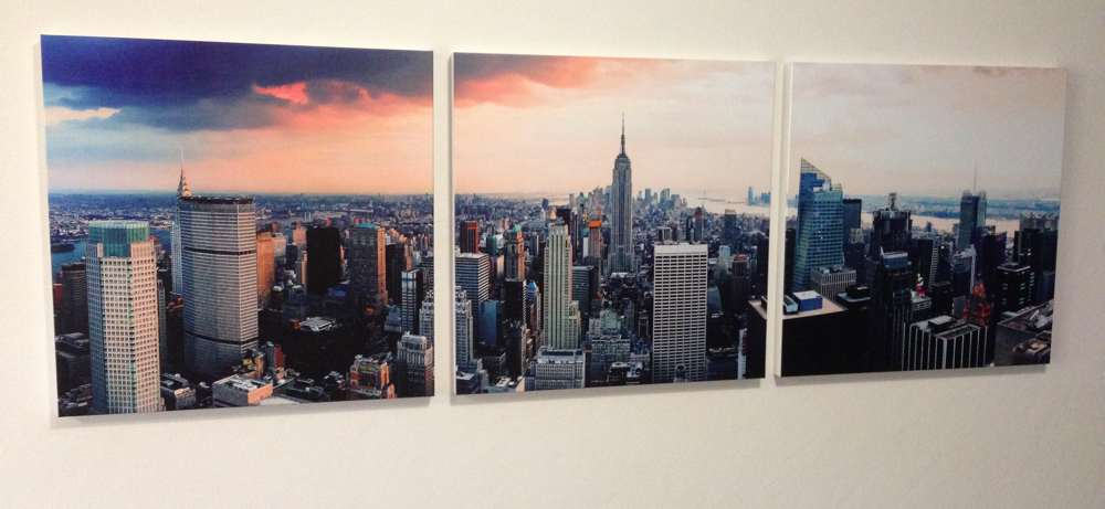 A  triptych of photographs hung by professional picture hanger John Verhoeven