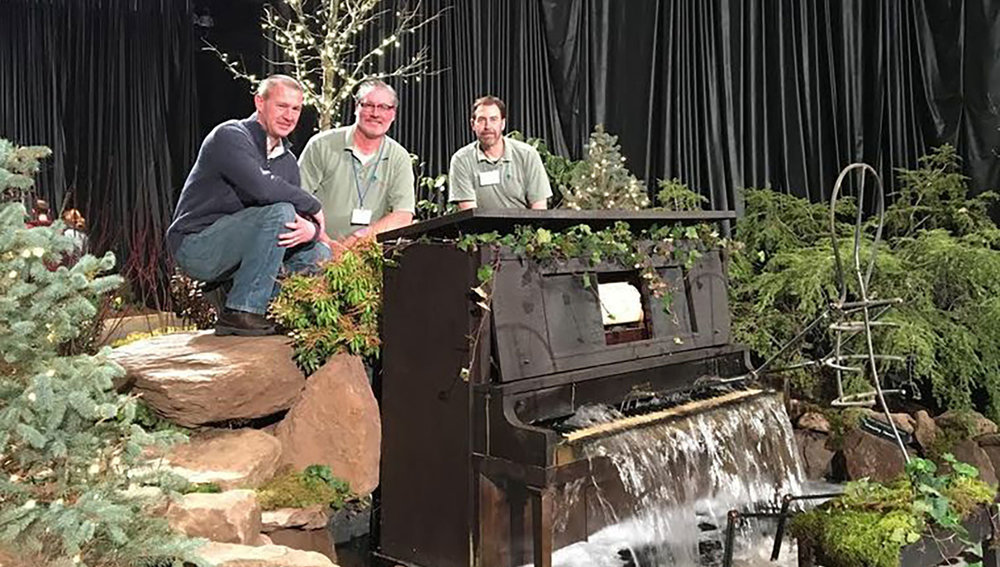 Hartford, Connecticut  - Scott Walowski, Steve Walowski & John Wilcox of Hillside Landscaping Co. and their award-winning landscape design display featuring a Piano waterfall at the 2016 Connecticut Garden & Flower Show.