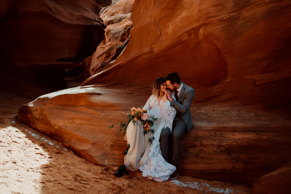 I love this sweet moment between a bride and groom on their wedding day in Arizona slot canyons.