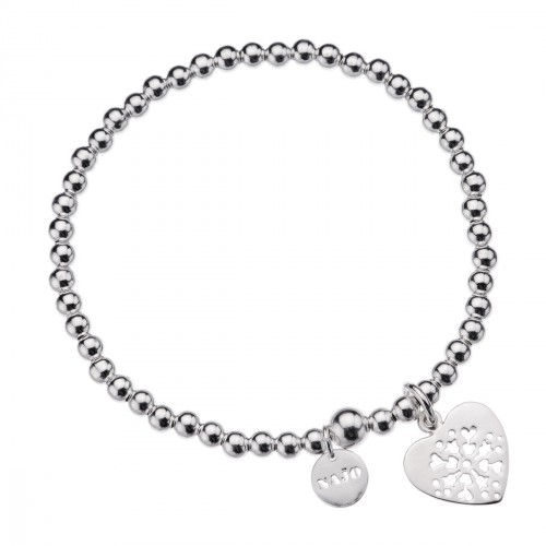 Capturing the world's most beloved icon, this contemporary bracelet adds a joyful finish to every look. Artisan silversmiths have sculpted balls from sterling silver to create a gorgeous effect before adding the intricate cut-out charm. Romantic and graceful, it makes a heartfelt gift for someone special. sterling silver cut out heart charm - $99.