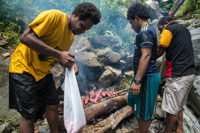 cooking-sweet-potatoes-at-the-waterfal-Sentani-Papua-Indonesia-Naomi-VanDoren