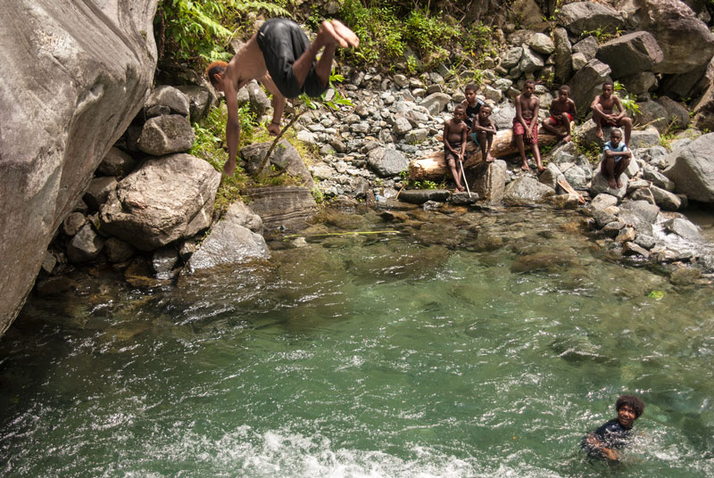 jumping-off-rocks-waterfal-Sentani-Papua-Indonesia-Naomi-VanDoren.jpg