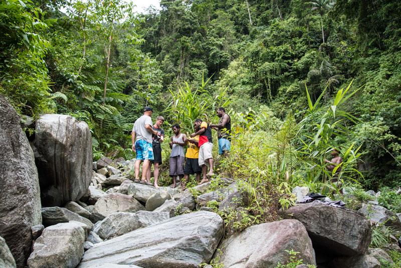 grass-slingshots-waterfal-trip-Sentani-Papua-Indonesia-Naomi-VanDoren.jpg