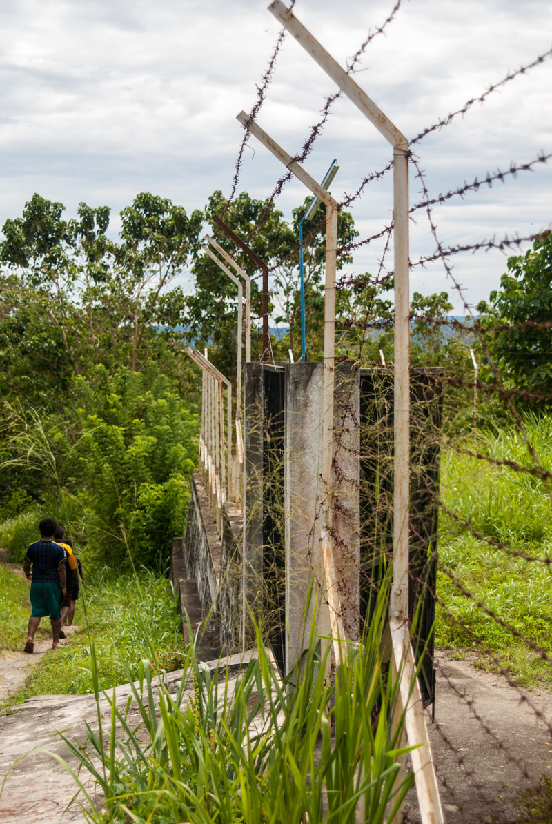 fence-walk-down-waterfal-trip-Sentani-Papua-Indonesia-Naomi-VanDoren.jpg