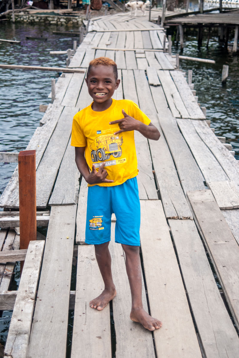local-boy-lake-sentani-papua-Indonesia-Naomi-VanDoren.jpg
