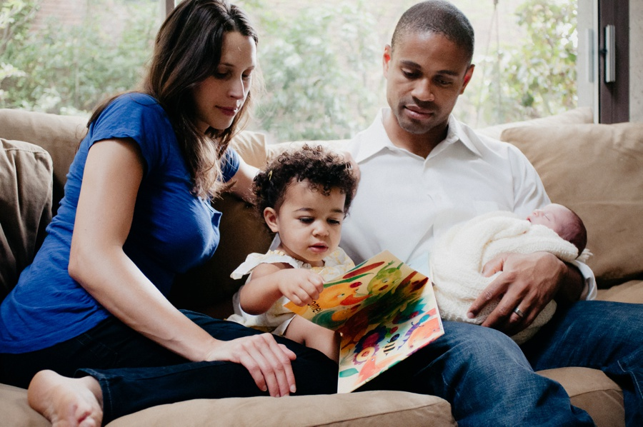 mom and dad reading with toddler