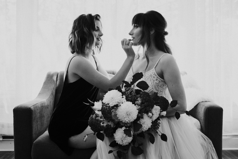 maid of honor helping bride