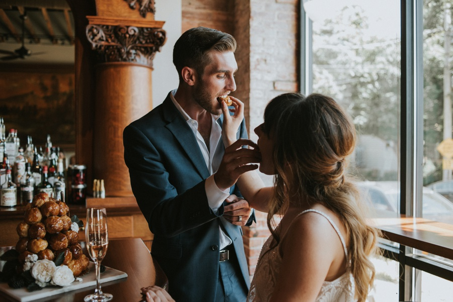 bride and groom eating cake